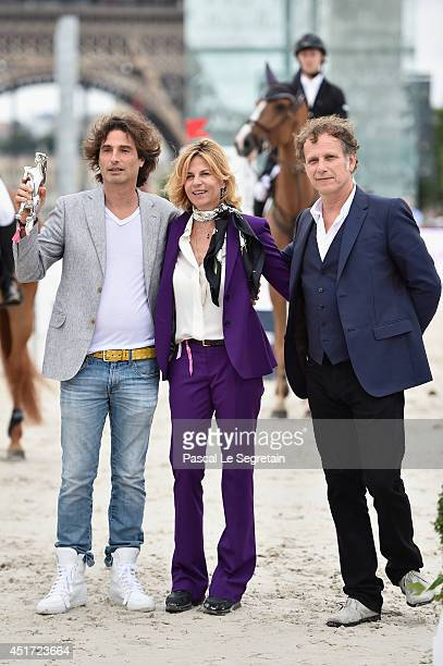 Richard Orlinski Virginie CouperieEiffel and Charles Berling attend the Paris Eiffel Jumping presented by Gucci at ChampdeMars on July 5 2014 in...