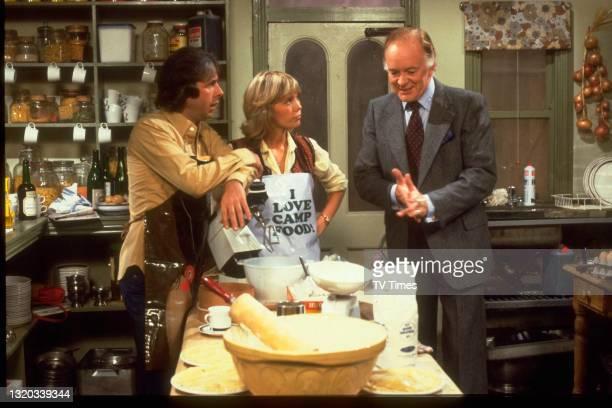 Richard O'Sullivan, Tessa Wyatt and Tony Britton in character as Robin Tripp, Vicky Nicholls and Tony Nicholls on the set of sitcom Robin's Nest,...