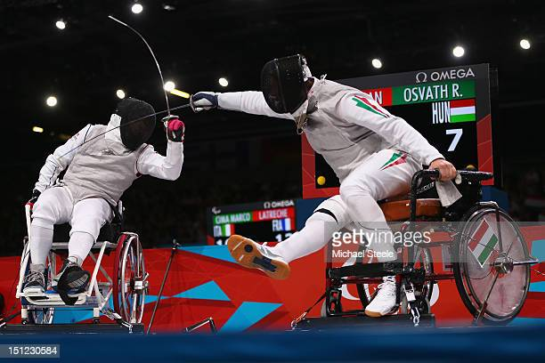 Richard Osvath of Hungary in action against Damien Tokatlian of France during the Men's Individual Foil semifinal match during the Wheelchair Fencing...