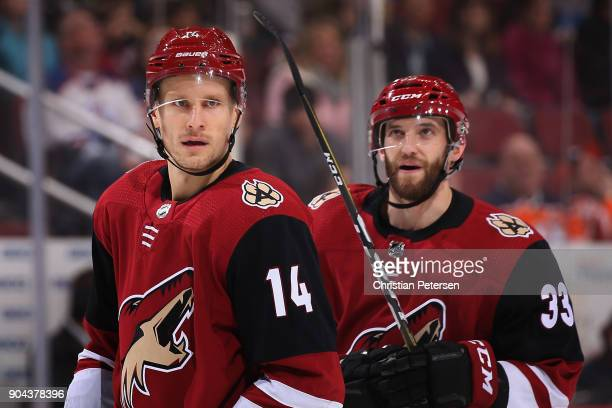 Richard Panik and Alex Goligoski of the Arizona Coyotes on the ice during a break from the first period of the NHL game against the Edmonton Oilers...