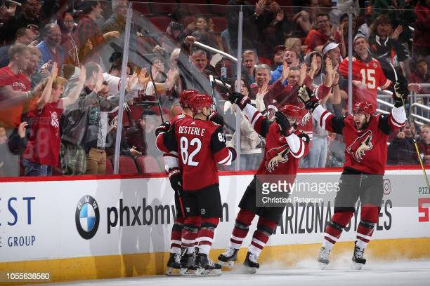 Richard Panik Jordan Oesterle Clayton Keller and Alex Galchenyuk of the Arizona Coyotes celebrate after Panik scored a goal against the Ottawa...