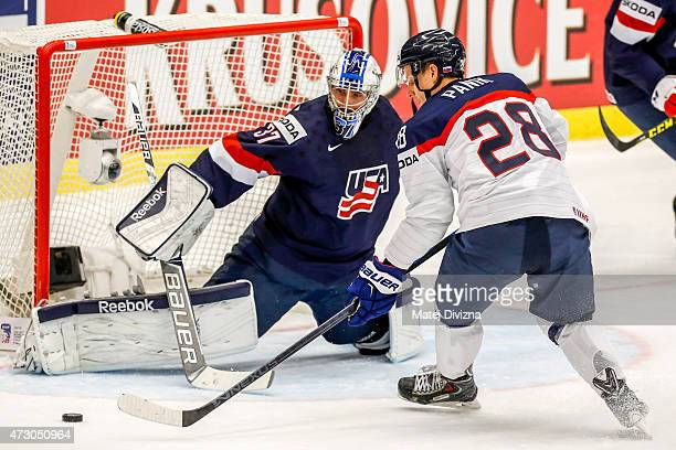 Richard Panik of Slovakia tries to score against Connor Hellebuyck , goalkeeper of USA, during the IIHF World Championship group B match between USA...