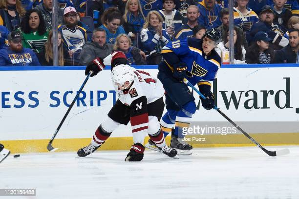 Richard Panik of the Arizona Coyotes and Alexander Steen of the St Louis Blues look for control of the puck at Enterprise Center on March 12 2019 in...