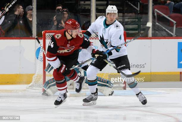 Richard Panik of the Arizona Coyotes and Brenden Dillon of the San Jose Sharks battle for position in front of the goal during the first period at...