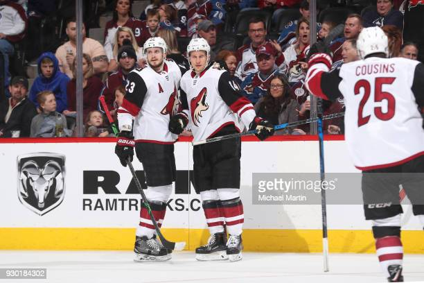 Richard Panik of the Arizona Coyotes celebrates a goal against the Colorado Avalanche with teammates Oliver EkmanLarsson and Nick Cousins at the...