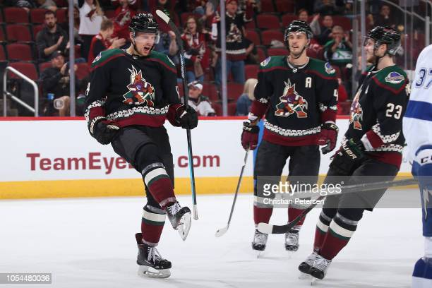Richard Panik of the Arizona Coyotes celebrates alongside Niklas Hjalmarsson and Oliver EkmanLarsson after scoring a goal against the Tampa Bay...