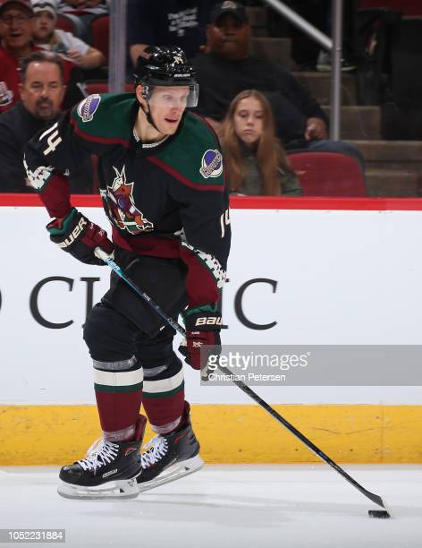 Richard Panik of the Arizona Coyotes skates with the puck against the Buffalo Sabres during the NHL game at Gila River Arena on October 13 2018 in...