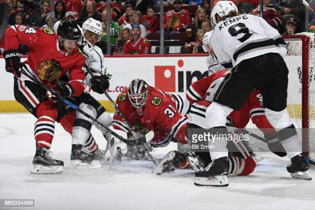 Richard Panik of the Chicago Blackhawks and Marian Gaborik of the Los Angeles Kings battle for the puck next to goalie Anton Forsberg in the second...