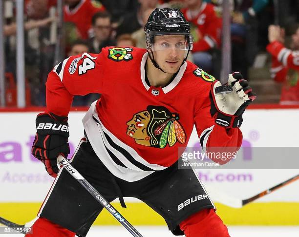Richard Panik of the Chicago Blackhawks catches the puck against the Anaheim Ducks at the United Center on November 27 2017 in Chicago Illinois The...