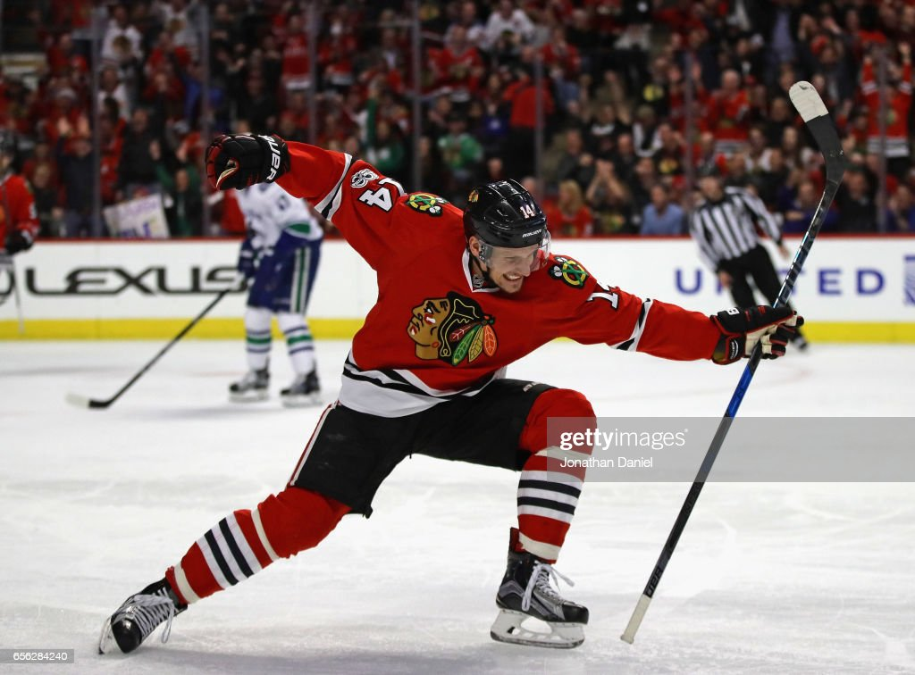Richard Panik #14 of the Chicago Blackhawks celebrates a third period goal against the Vancouver Canucks at the United Center on March 21, 2017 in Chicago, Illinois. The Canucks defeated the Blackhawks 5-4 in overtime.