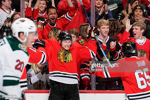 Richard Panik of the Chicago Blackhawks reacts after scoring against the Minnesota Wild in the second period of the NHL game at the United Center on...