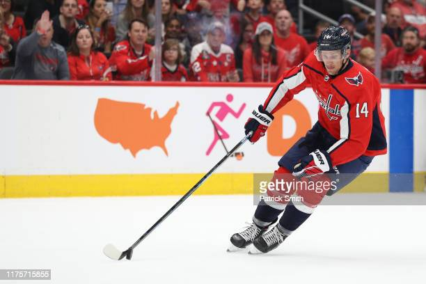 Richard Panik of the Washington Capitals skates with the puck against the St Louis Blues during a preseason NHL game at Capital One Arena on...
