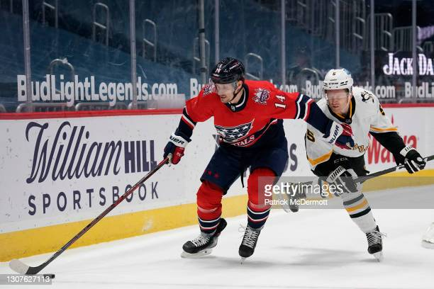 Richard Panik of the Washington Capitals skates with the puck against Mike Matheson of the Pittsburgh Penguins in the first period at Capital One...