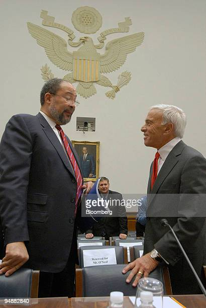 Richard Parsons chairman of Time Warner Inc and a member of the board of Citigroup Inc left chats with Angelo Mozilo chief executive officer of...