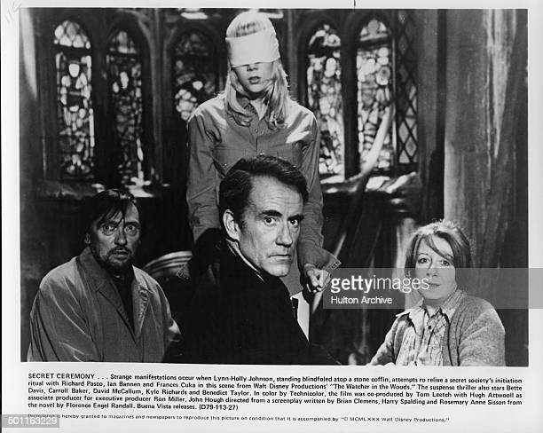 Richard Pasco LynnHolly Johnson Ian Bannen and Frances Cuka perform a ritual in a scene for the Walt Disney movie The Watcher in the Woods circa 1979