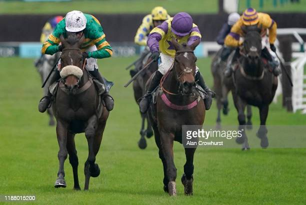 Richard Patrick riding Happy Diva clear the last to win The BetVictor Gold Cup Handicap Chase from Barry Geraghty and Brelan D'As at Cheltenham...
