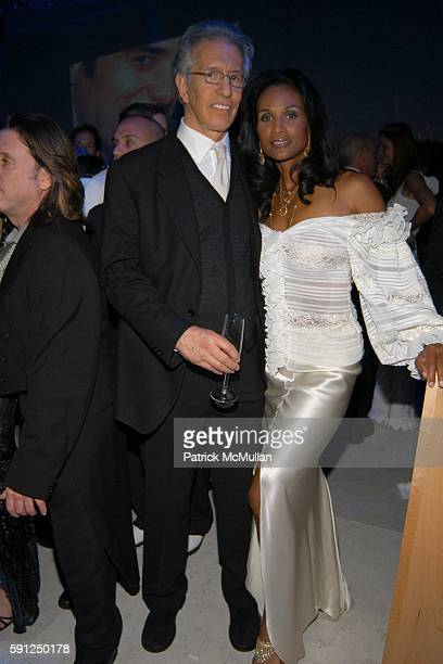 Richard Perry and Beverly Johnson attend Vanity Fair Oscar Party at Morton's Restaurant on February 27 2005 in Los Angeles California