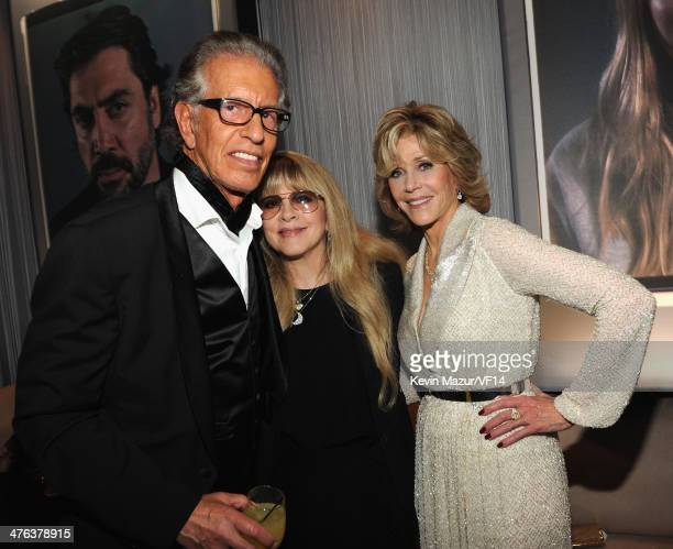 Richard Perry Stevie Nicks and Jane Fonda attend the 2014 Vanity Fair Oscar Party Hosted By Graydon Carter on March 2 2014 in West Hollywood...