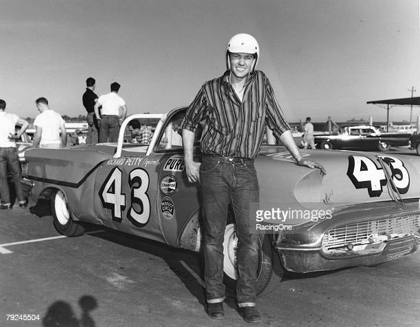 Richard Petty and his 1957 Oldsmobile convertible at the first annual Daytona 500 February 22 1959 in Daytona Beach Florida Petty fell out of the...