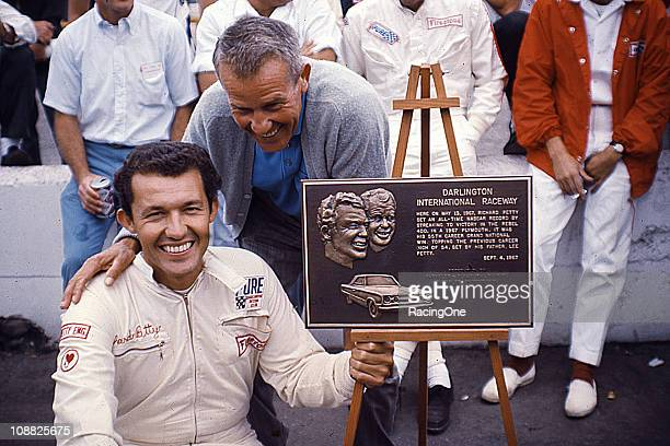 Richard Petty and his father Lee Petty pose with a plaque given to Richard by Darlington Raceway. The plaque commemorates the younger PettyÕs 55th...