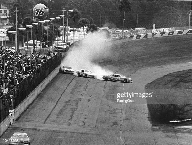 Richard Petty Darrell Waltrip and David Pearson spin after a tire went down on PettyÕs Dodge causing the three to tangle coming off turn four on lap...