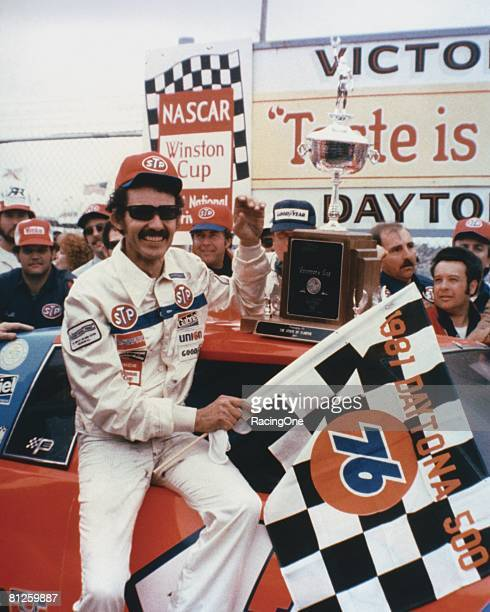 Richard Petty driver of the STP Buick celebrates in victory lane after winning the Winston Cup Daytona 500 on February 17 1974 at the Daytona...