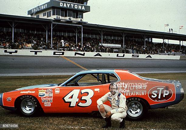 Richard Petty driver of the STP Dodge poses for a portrait in front of his car before a race on February 18 1973 in Daytona Beach Florida In the...
