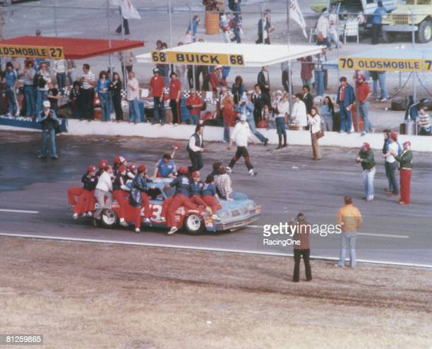 Richard Petty driver of the STP Oldsmobile drives to victory lane after winning the Winston Cup Daytona 500 on February 18 1979 at the Daytona...