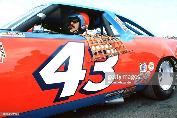 Richard Petty driver of the STP Pontiac sits in his race car just before the start of the 1980 Daytona 500 on February 17 1980 at the Daytona...