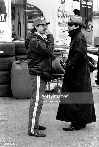 Richard Petty driver of the STP Pontiac talks with his son Kyle Petty in the garage at Daytona International Speedway prior to the start of the 1984...