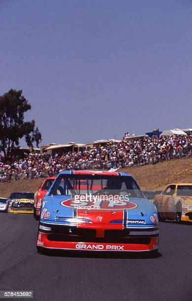 Richard Petty drives his No 43 STP Pontiac in the Save Mart 300K roadcourse event at Sonoma Raceway in Sonoma California amid his final NASCAR season...
