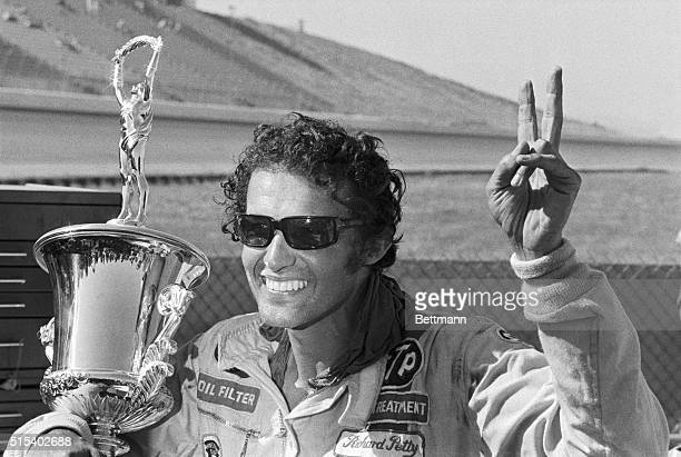 Richard Petty flashes a victory sign after winning the Lone Star 500 6/25 in a 71' Dodge at an average speed of 144.185 mph.