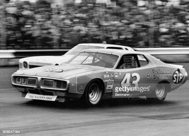 Richard Petty guides his '75 Doge past Bennie Parsons' Chevy early in the NASCAR 500 at Richmond Petty took the honors and the $6265 winners purse...