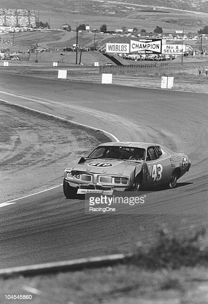 Richard Petty guides his battered Dodge around the road course during the Winston Western 500 NASCAR Cup race at Riverside International Raceway...