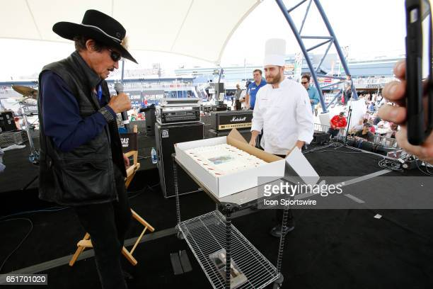 Richard Petty is presented a birthday cake by LVMS on the Neon Garage Stage during Stratosphere Pole Day for the Kobalt 400 NASCAR Monster Energy Cup...
