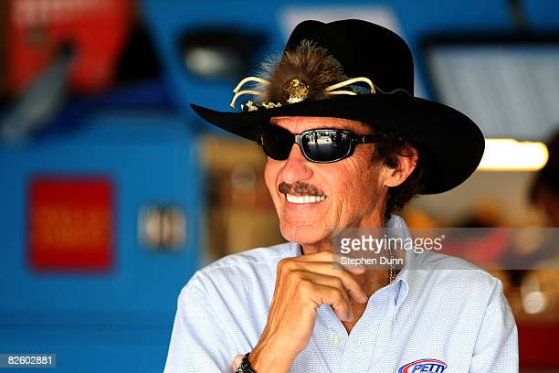 Richard Petty past NASCAR champion and team owner of Petty Enterprises stands in the garage during practice for the NASCAR Sprint Cup Series Pepsi...