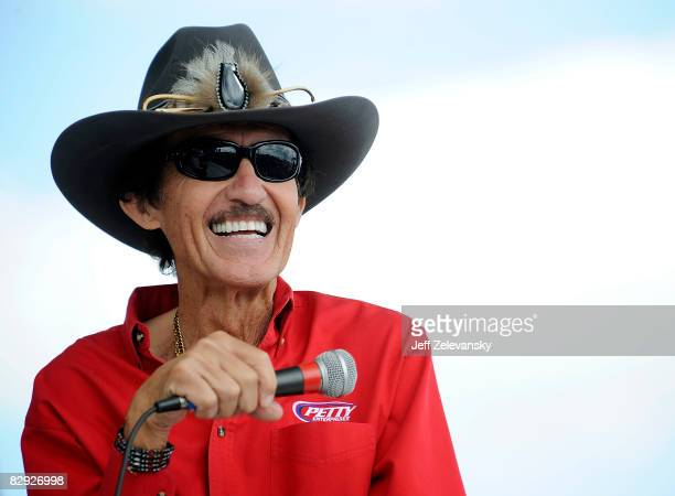 Richard Petty speaks to fans during practice for the NASCAR Sprint Cup Series Camping World RV 400 at Dover International Speedway on September 20,...