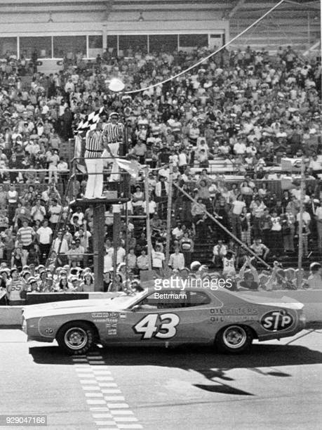 Richard Petty takes the checkered flag winning the Winston Cup Music City 420 NASCAR Race for the eighth time in ten years Twentyeight cars started...