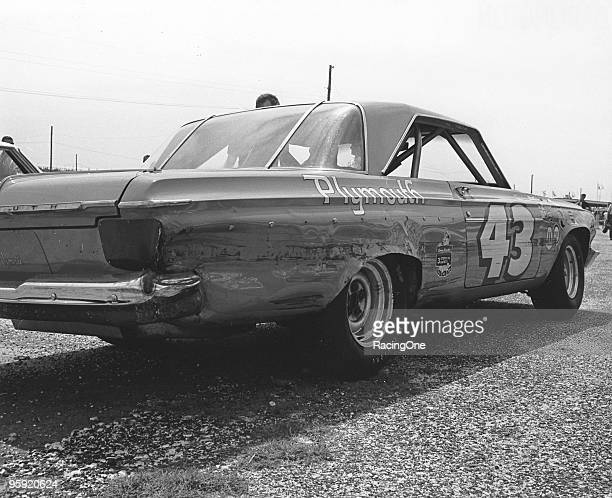 """Richard Petty's '64 Plymouth Belvedere shows the """"Darlington Stripe"""" after some scrapes during the Southern 500 on September 7, 1964 in Darlington,..."""