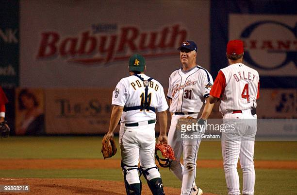 Richard Pombo John Shimkus and coach Mike Oxley have a little meeting of the minds after the Democrat's rallied in the last inning during the 2003...