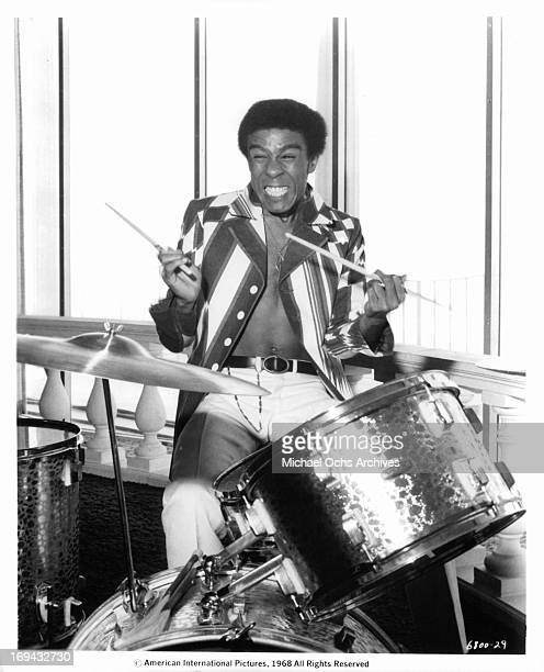 Richard Pryor playing the drums in a scene from the film 'Wild In The Streets', 1968.