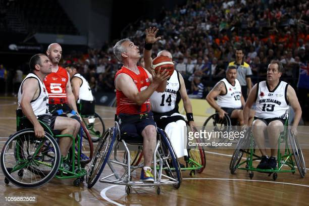 Richard Pullen of the United Kingdom shoots in the bronze medal match of the Wheelchair Basketball between New Zealand and the United Kingdom during...