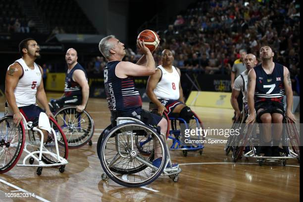 Richard Pullen of the United Kingdom shoots in the semifinal of the Wheelchair Basketball between the United Kingdom and the United States during day...
