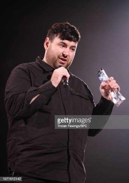 Richard Quinn winner of the British Emerging Talent Womenswear award on stage during The Fashion Awards 2018 In Partnership With Swarovski at Royal...