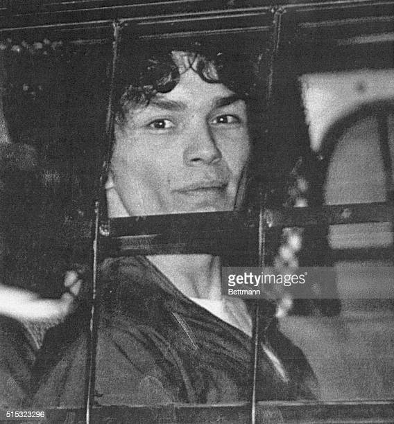 Richard Ramirez accused of being the Los Angeles area serial killer called the Night Stalker looks out the window of a police van Ramirez pleaded...
