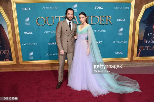 Richard Rankin and Sophie Skelton attend the Starz Premiere event for Outlander Season 5 at Hollywood Palladium on February 13 2020 in Los Angeles...