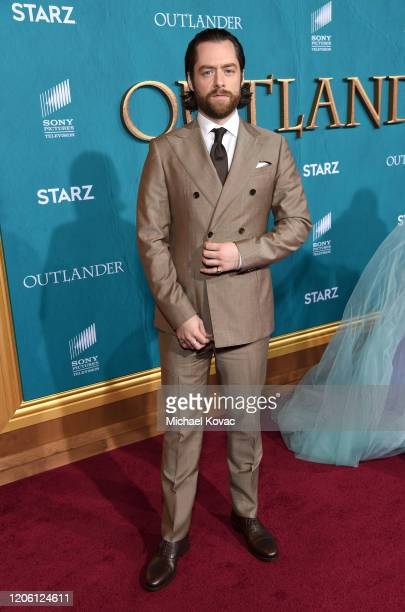 Richard Rankin attends the Starz Premiere event for Outlander Season 5 at Hollywood Palladium on February 13 2020 in Los Angeles California