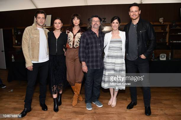 Richard Rankin Sophie Skelton Caitriona Balfe Maril Davis Ronald D Moore and Sam Heughan attend as Starz brings Outlander to NYCC 2018 at Javits...