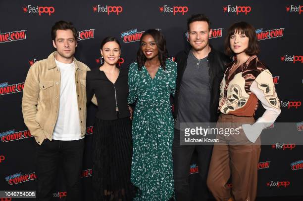 Richard Rankin, Sophie Skelton, Lola Ogunnaike, Sam Heughan and Caitriona Balfe attend as Starz brings Outlander to NYCC 2018 at Javits Center on...
