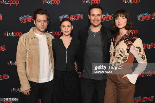 Richard Rankin Sophie Skelton Sam Heughan and Caitriona Balfe attend as Starz brings Outlander to NYCC 2018 at Javits Center on October 6 2018 in New...